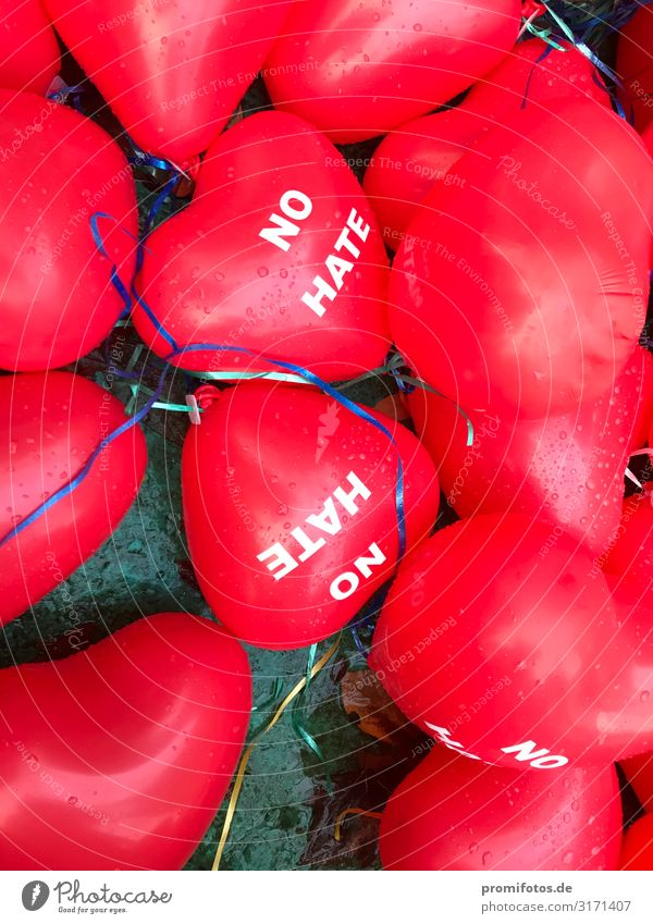 """Red balloons """"NO HATE"""" in the autumn Well-being Contentment Characters Flying Lie Infinity Protection Hospitality Solidarity Hatred Balloon Politics and state"""