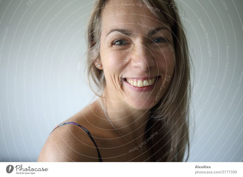 Portrait of a smiling woman with long blond hair Style Joy pretty Life Well-being Woman Adults Face 30 - 45 years Blonde Long-haired Freckles Smiling Laughter