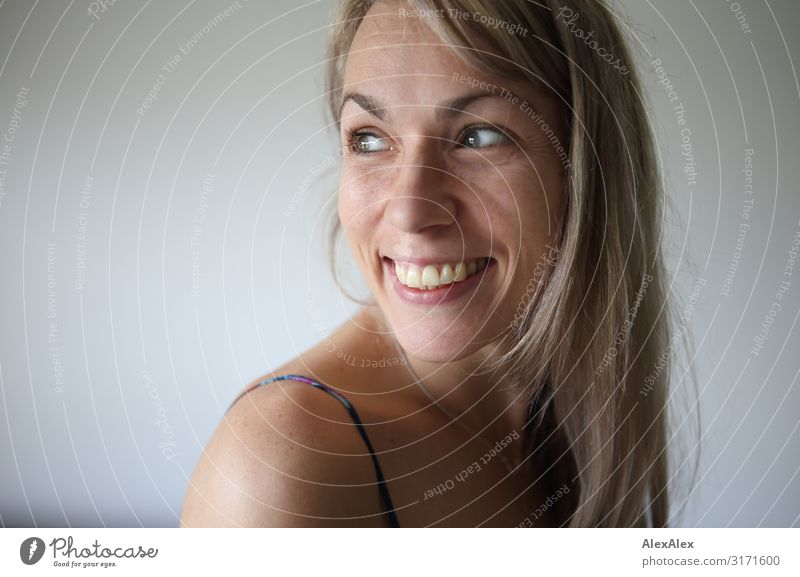Side portrait of smiling woman with long blond hair Style Joy pretty Life Contentment Woman Adults Face 30 - 45 years Blonde Long-haired Freckles Shoulder
