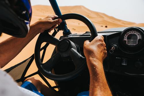 Man driving an off road buggy in Shara desert. Vacation & Travel Trip Adventure Expedition Sports Engines Adults Hand 1 Human being Nature Sand Desert Transport