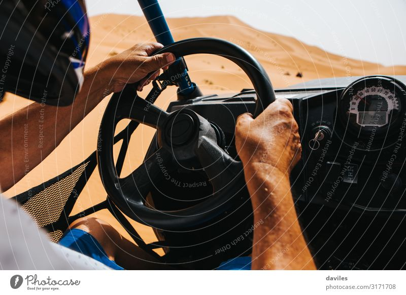 Man driving an off road buggy in Shara desert. Human being Vacation & Travel Nature Hand Adults Sports Sand Trip Car Transport Adventure Speed Driving Desert