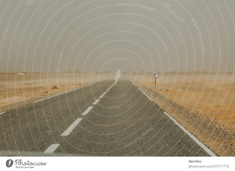 A straight road in Morocco during sandstorm Vacation & Travel Tourism Trip Nature Landscape Sand Sky Clouds Horizon Weather Storm Warmth Desert Places Transport