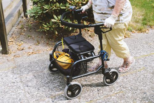 Senior citizen with rollator Lifestyle Shopping Health care Summer Technology Human being Woman Adults Female senior Legs Feet 1 60 years and older To hold on
