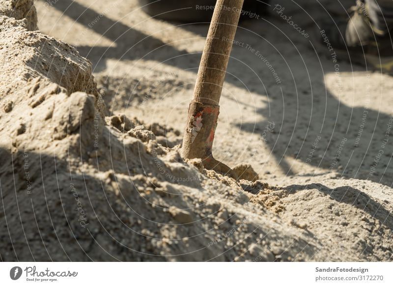 Construction site work with concrete mixer and wheelbarrows Work and employment Profession Craftsperson Gardening Workplace Industry Craft (trade) Sand