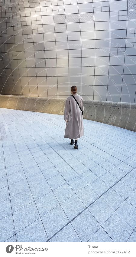 she walks alone/ woman walks alone on an otherwise deserted futuristic-looking square Woman Adults 1 Human being 18 - 30 years Youth (Young adults) Architecture