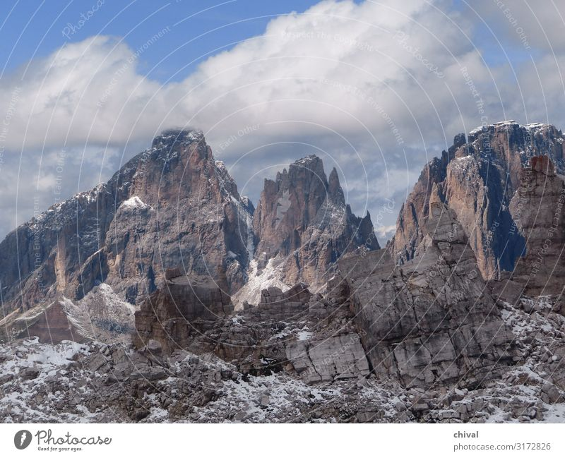 Dolomites Environment Nature Landscape Air Sky Clouds Bad weather Ice Frost Snow Rock Alps Mountain Peak Gigantic Wild Blue Gray White Moody Colour photo