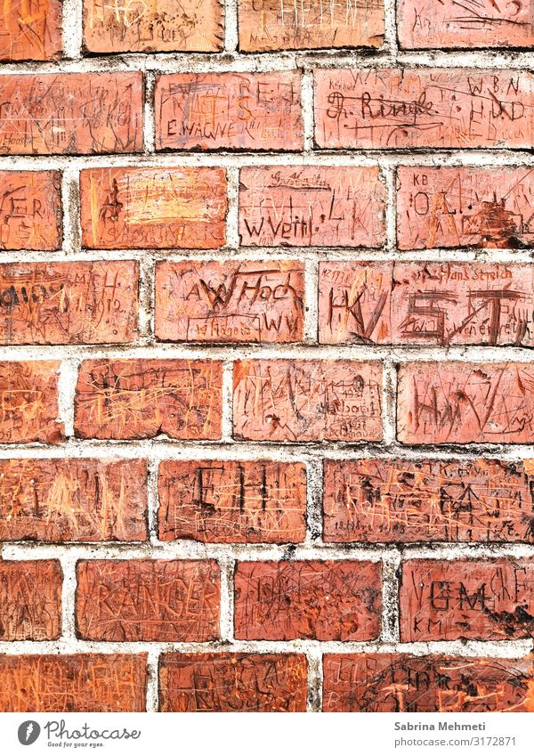 brick wall Environment Manmade structures Facade Sign Characters Digits and numbers Graffiti Orange Romance Past Colour photo Exterior shot