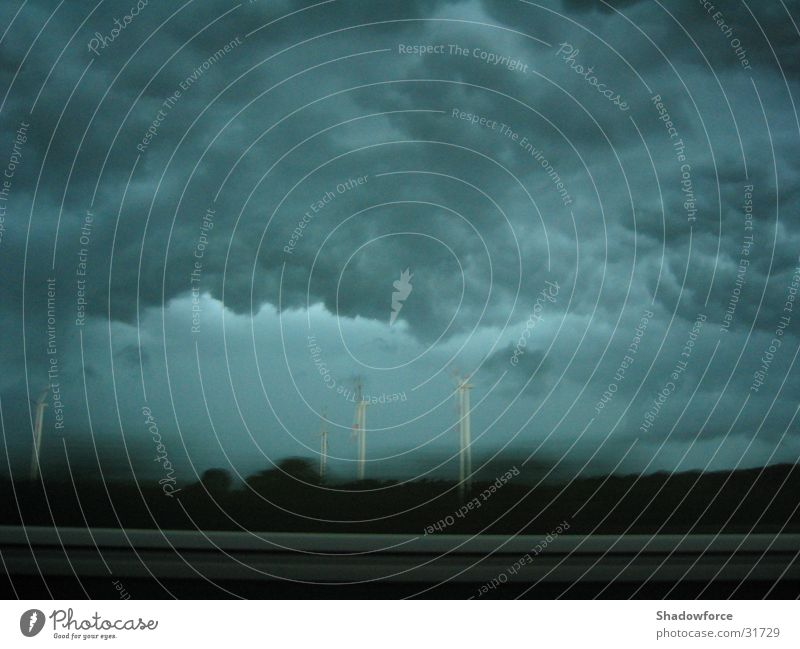 Storm front I Gale Clouds Dark Highway Gray Threat Thunder and lightning Rain Wind energy plant Sky