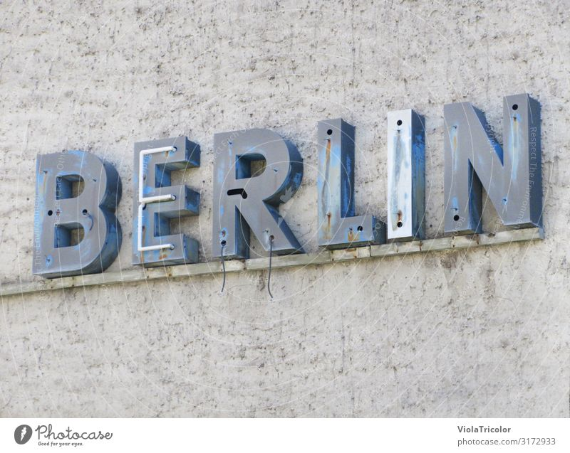 Vacation & Travel Old Blue Town Architecture Wall (building) Berlin Building Tourism Wall (barrier) Stone Facade Gray Metal Characters Signs and labeling