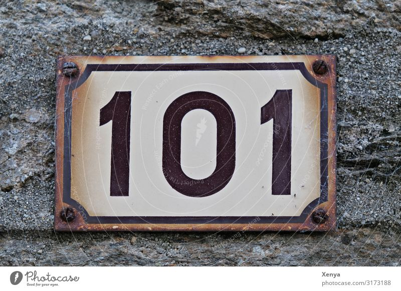 Shield 101 Wall (barrier) Wall (building) Facade Stone Metal Brown Gray White House number Digits and numbers Rust Tin plate sign Old Subdued colour