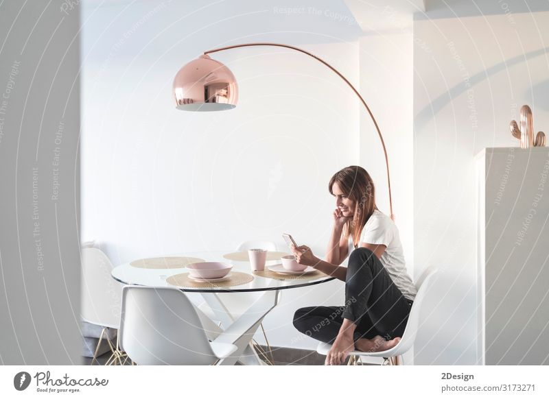adult woman sitting at living room while using phone Lifestyle Happy Beautiful Relaxation Flat (apartment) House (Residential Structure) Desk Sofa Table
