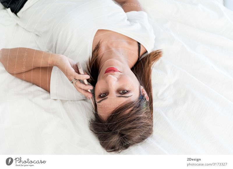 Above view of a Laughing woman talking on cell Lifestyle Happy Beautiful To talk Telephone PDA Human being Feminine Young woman Youth (Young adults) Woman