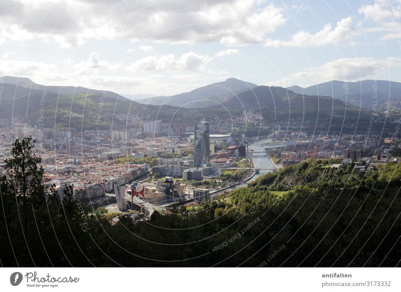 In the far distance Bilbao Town Guggenheim Museum Exterior shot Architecture Sky Deserted Day Downtown Tourism Mountain Vacation & Travel City trip Europe