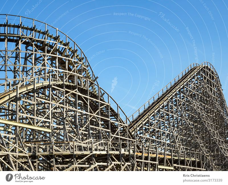 Wooden roller coaster Summer Summer vacation Blue Brown Joy Roller coaster Theme-park rides Amusement Park Happiness Ride Thrill Colour photo Day Sunlight