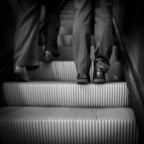 overtaking manoeuvre Human being Masculine Man Adults Legs 2 Berlin Railway station Zoologischer Garten Train station Escalator Suit Footwear Movement Driving