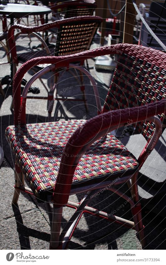 Wicker chair on a sun terrace in a street cafe Chair Sun Shadow Terrace out sunshine basketwork Deserted Exterior shot Gastronomy Sidewalk café Table