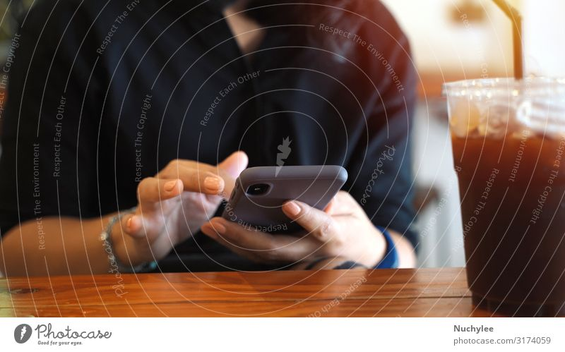 Young customer woman using smartphone while drinking iced coffee Coffee Lifestyle Style Beautiful Relaxation Summer Table Restaurant Work and employment