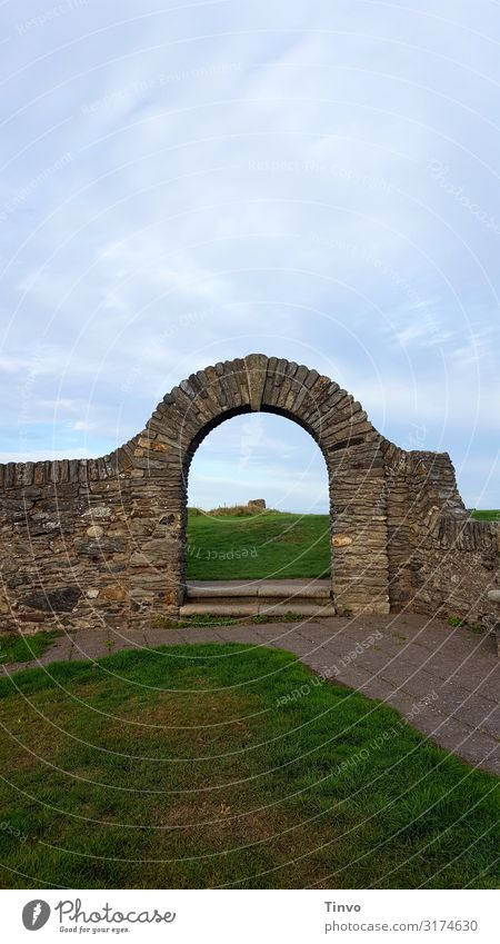 wall arch Grass Ruin Gate Architecture Wall (barrier) Wall (building) Old Historic Blue Brown Green Curiosity Vacation & Travel Past wall passage Passage