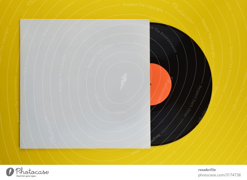 old black vinyl record half in neutral white record sleeve on yellow background | old Record LP Ancient Retro vintage Music cover Sheath Record sleeve Yellow