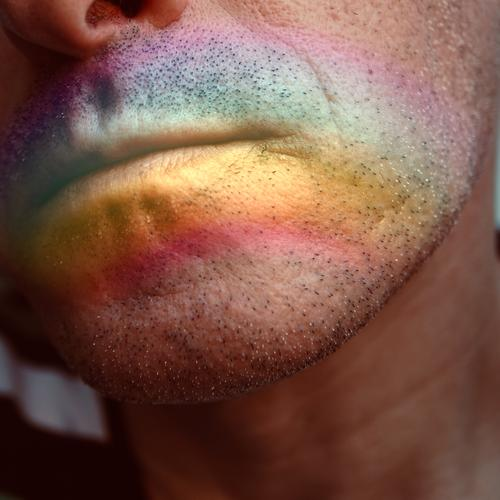 face with a rainbow on the lips Human being Man Colour Face Decoration Skin Symbols and metaphors Lips Painted Homosexual Rainbow Pride Tolerant Rainbow flag