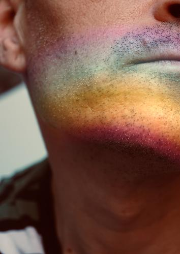 man with painted face with a rainbow Face Lips Man Human being Rainbow Symbols and metaphors Colour Multicoloured Rainbow flag Homosexual Pride diversity