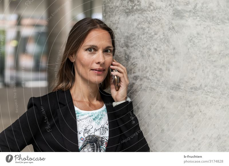 Woman with Smartphone Office Economy Business Career Meeting Cellphone Adults Face 1 Human being 30 - 45 years Town Bank building Wall (barrier) Wall (building)