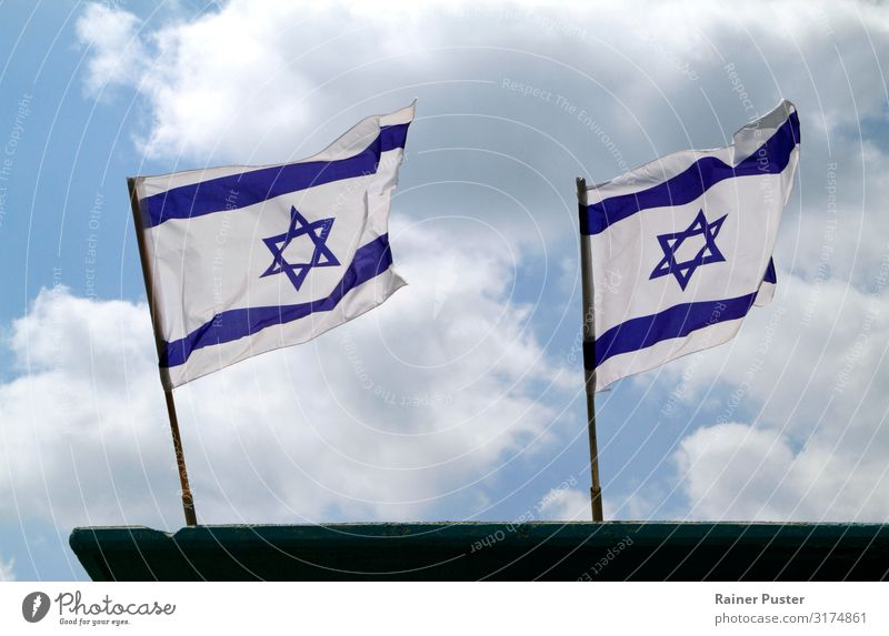 Two Israeli national flags in the wind Sky Clouds Wind Tel Aviv Ensign Flagpole Blue White Blow Colour photo Exterior shot Copy Space bottom Copy Space middle