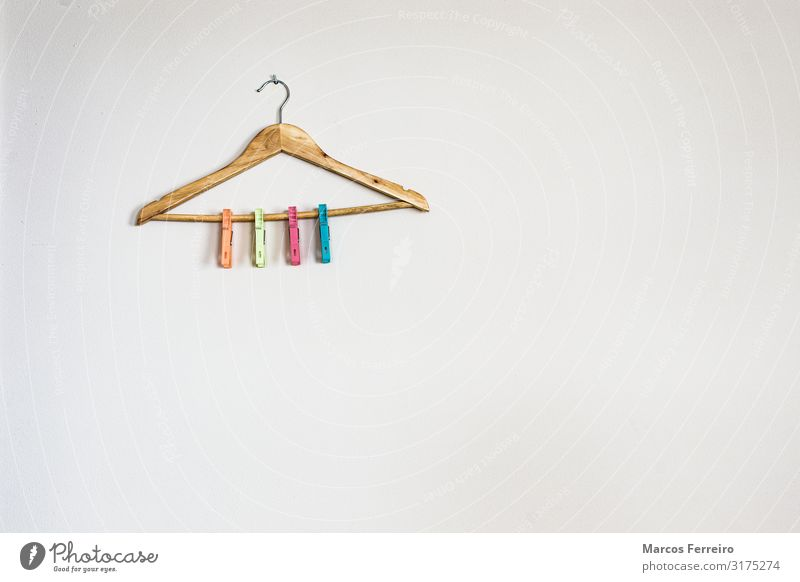 hanger with colorful clothespins on white wall Lifestyle House (Residential Structure) Clothing Plastic Hang Green Pink Red Colour tops changing Home Selection