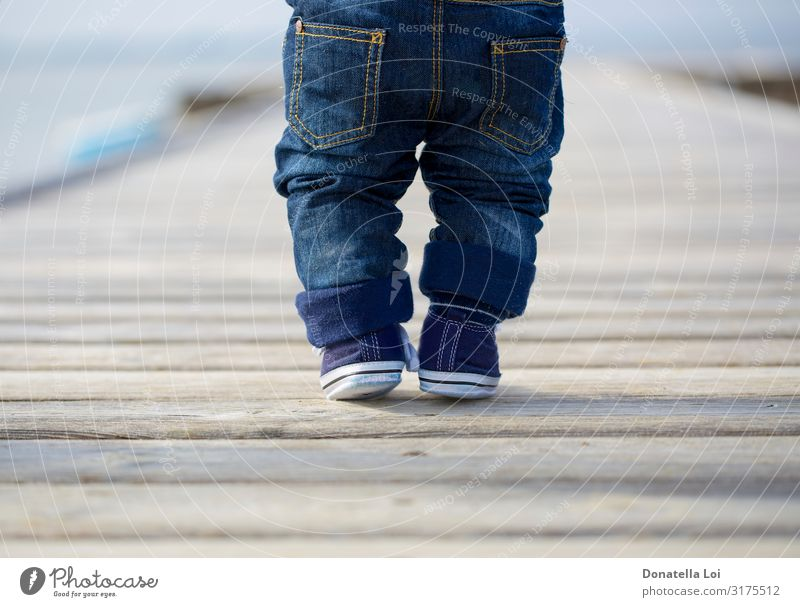 Baby legs in jeans on pier Lifestyle Summer Child Human being Masculine Toddler Boy (child) Infancy Legs Feet 1 0 - 12 months Pants Jeans Footwear Sneakers Wood