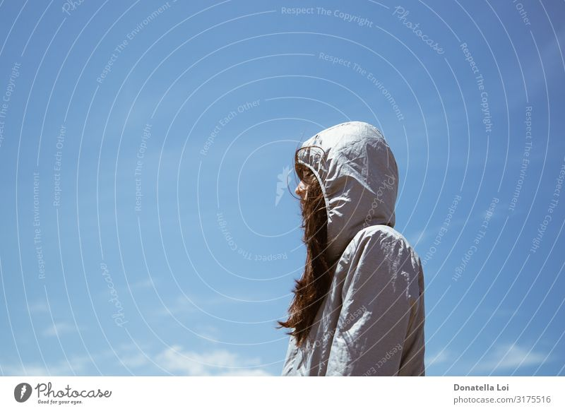 Hodeed pensive girl from profile Lifestyle Vacation & Travel Freedom Human being Young woman Youth (Young adults) Woman Adults 1 13 - 18 years Sky Wind Jacket