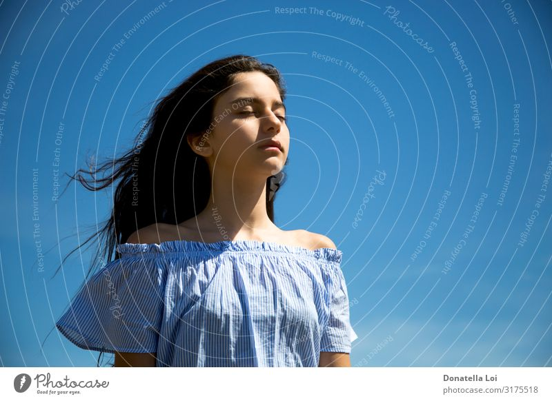 Girl with closed eyes Woman Human being Sky Vacation & Travel Youth (Young adults) Summer Blue Relaxation Loneliness Calm Face Lifestyle Adults Feminine
