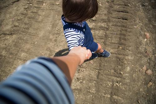 Mother and son holding hands Child Human being Vacation & Travel Summer Hand Far-off places Adults Tourism Together Field Infancy Adventure Walking Ground