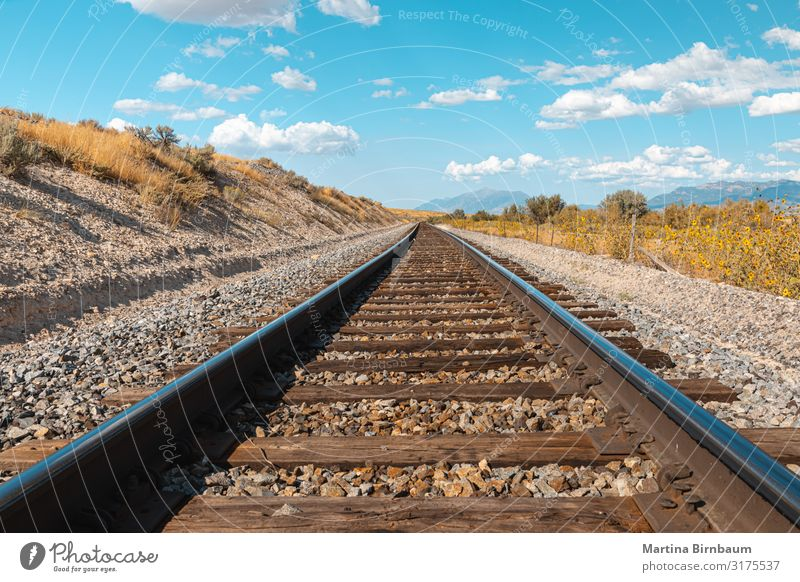 Straight railroad track in Utah, USA - the way forward Vacation & Travel Tourism Trip Summer Industry Nature Landscape Sky Clouds Transport Street