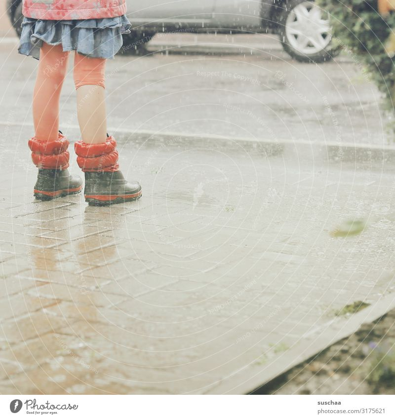 in the rain .. Child Girl Rain Rainwater Wet Water Legs Rubber boots Car Street Asphalt Joy Summer Courtyard entrance Weather