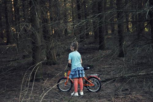 girl alone in the forest Child Girl Undergrowth Forest Tree Branch Woodground Dark Loneliness Individual Skirt Little Red Riding Hood Lost Doomed Search Bicycle