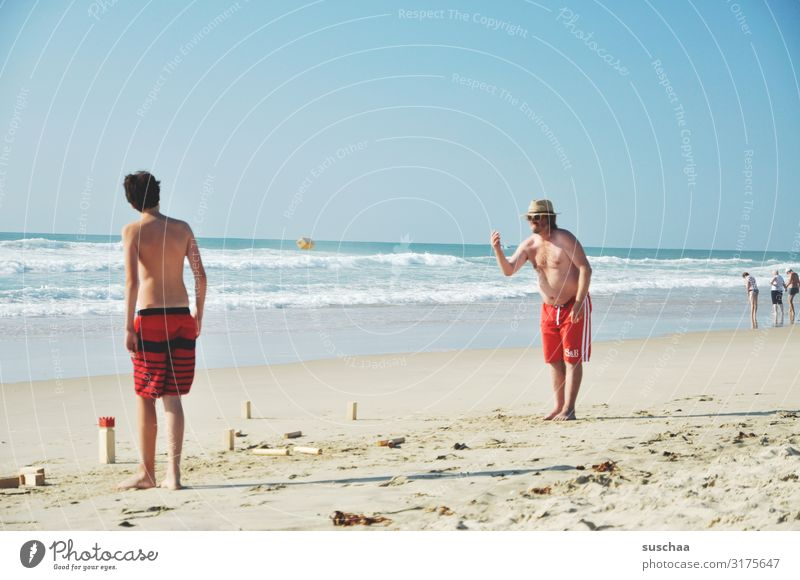 vacationers on the beach Man Summer Swimming trunks Ocean Atlantic Ocean Sandy beach wide holidays Holidaymakers Summer vacation Waves Vacation & Travel Beach