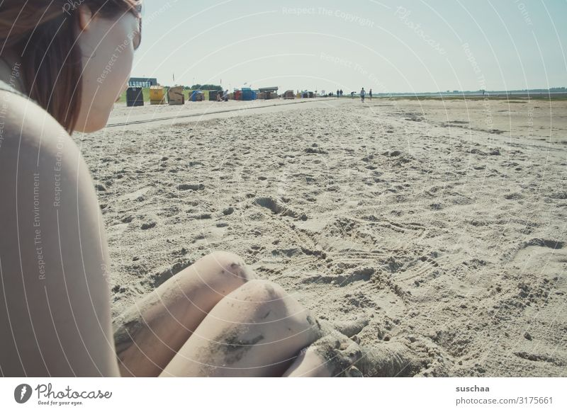 teenager sitting on a beach in the sand of the wadden sea Tourism Relaxation Exterior shot Far-off places Coast Mud flats Vacation & Travel Horizon Water Tide