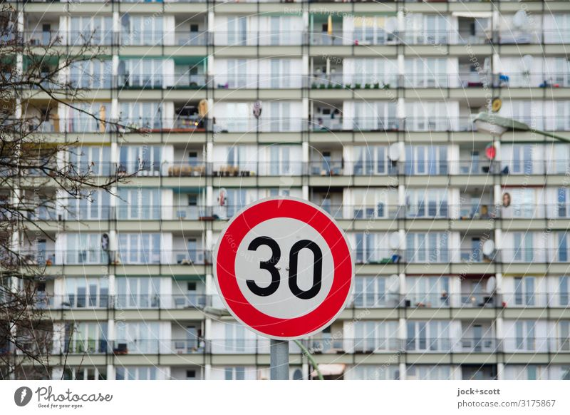 Façade blurred at 30 km/h Winter Branch Schöneberg Town house (City: Block of flats) Prefab construction Tower block Facade Road sign Speed limit Authentic