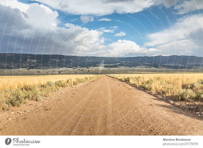 Long straight dirt road in Utah with dramatic clouds Dessert Vacation & Travel Trip Freedom Summer Mountain Wallpaper Nature Landscape Sky Clouds Horizon