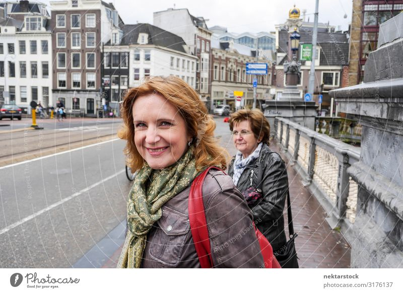 Two Middle Aged Women Standing on Bridge in Amsterdam Lifestyle Vacation & Travel Tourism Woman Adults Clouds Downtown Street Smiling White crossing real life
