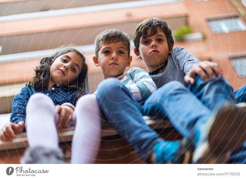 Three bad boys sitting on the neighborhood Lifestyle Joy Happy Beautiful Summer Living or residing House building Child School School building Schoolchild