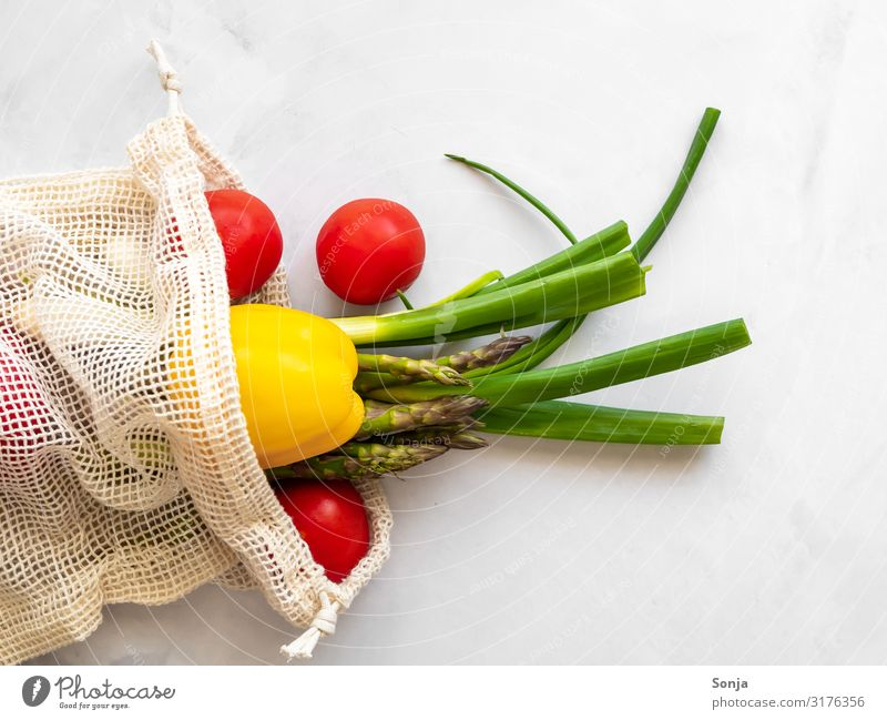 Fresh colourful vegetables in a shopping net Food Vegetable Leek vegetable Tomato Pepper Asparagus Nutrition Organic produce Vegetarian diet Diet Fasting