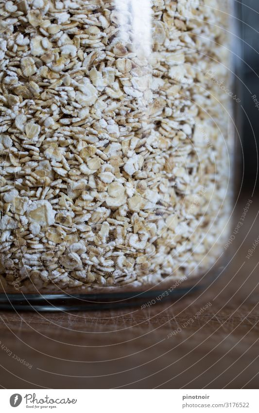 Oat flakes in glass Food Grain Breakfast Organic produce Vegetarian diet Diet Fasting Glass Shopping Save Healthy Eating Living or residing Kitchen Packaging