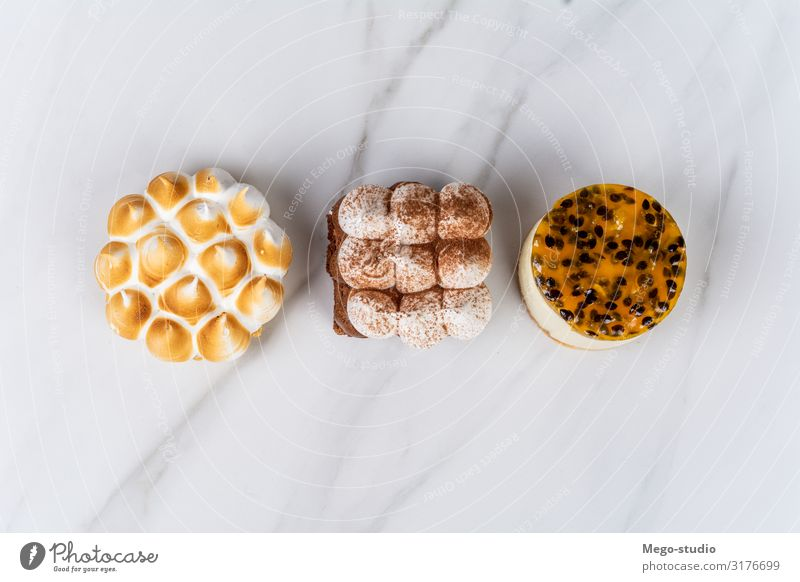 Mini chocolate, lemon pie and passion fruit cake. Dessert Eating Hot Chocolate Plate Decoration Kitchen Wood Dark Small Delicious Brown Appetite Lemon food