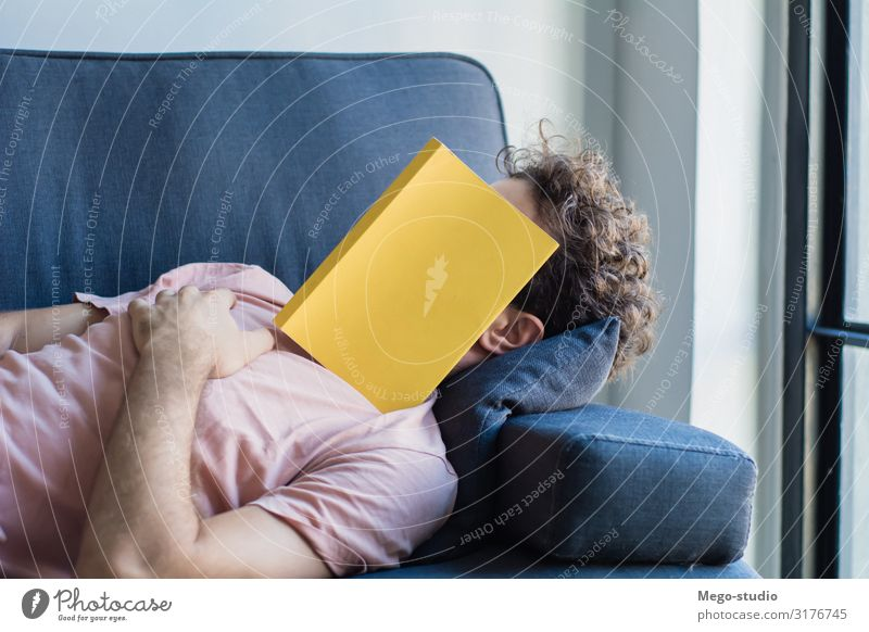 Man sleep on sofa with book cover his face Lifestyle Style Happy Face Relaxation Leisure and hobbies Reading House (Residential Structure) Sofa Business