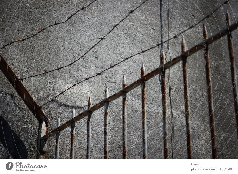 Stories from the fence (IV) | Weltschmerz Lisbon Wall (barrier) Wall (building) Fence Barbed wire Rust Wire Point Stone Metal Line Stripe Network Historic Gray