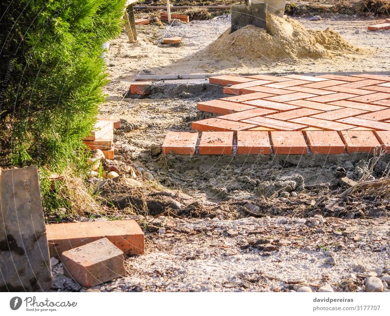 Orange brick paving stones in construction process Work and employment Profession Tool Sand Building Architecture Terrace Lanes & trails Stone Concrete Red Pave