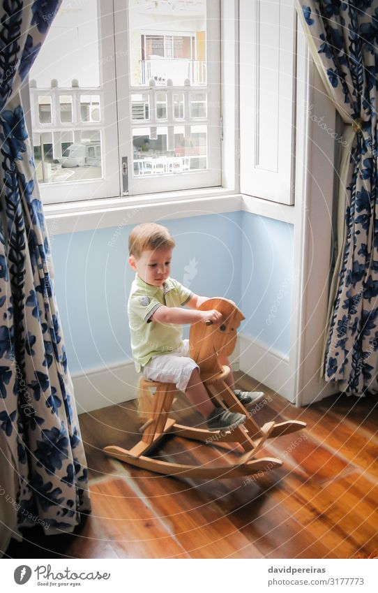 Little boy riding on vintage rocking horse Joy Playing Child Baby Toddler Boy (child) Infancy Horse Toys Wood Old Sit Cute Retro Brown Caucasian Gift ride