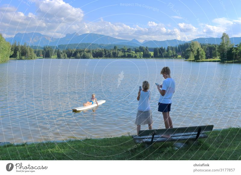 Family takes mobile phone photo at mountain lake Leisure and hobbies Vacation & Travel Tourism Trip Sports Fitness Sports Training Swimming & Bathing Girl