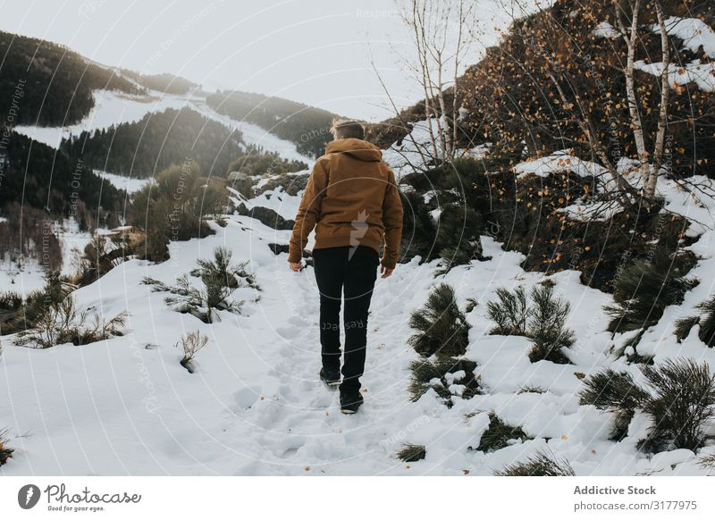 Man walking on footpath in snowy landscape Walking Snow Footpath Mountain Landscape Slope Nature Action hiker Day Movement Winter Weather traveler Going
